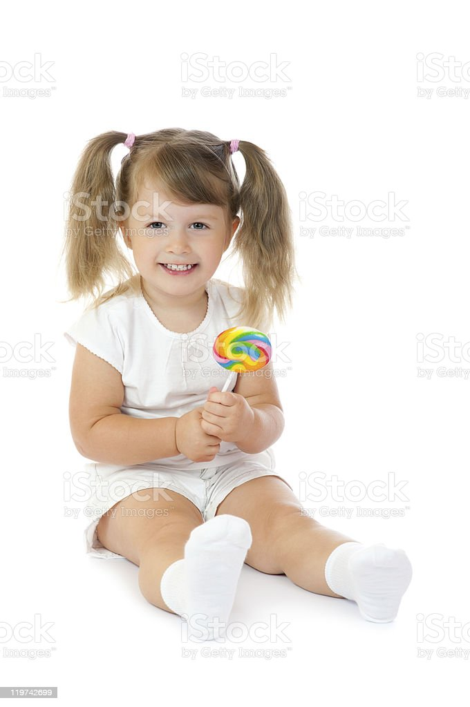 Small smiling girl with lollipop stock photo