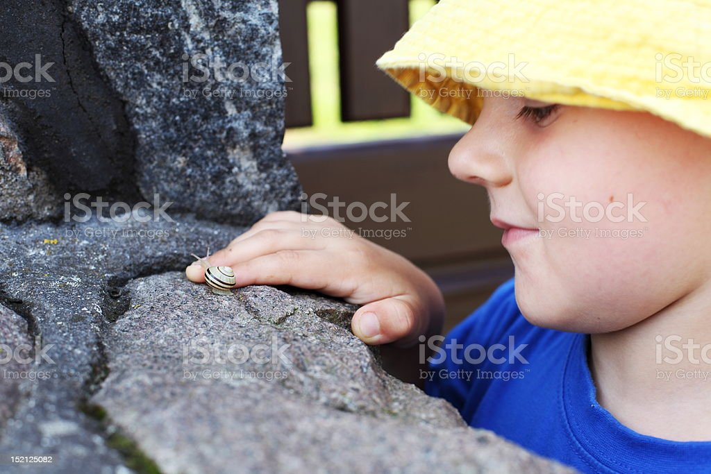small snail and a little boy royalty-free stock photo