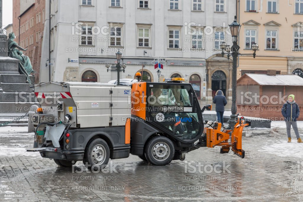 Small snow blower car works in Krakow, Poland. stock photo