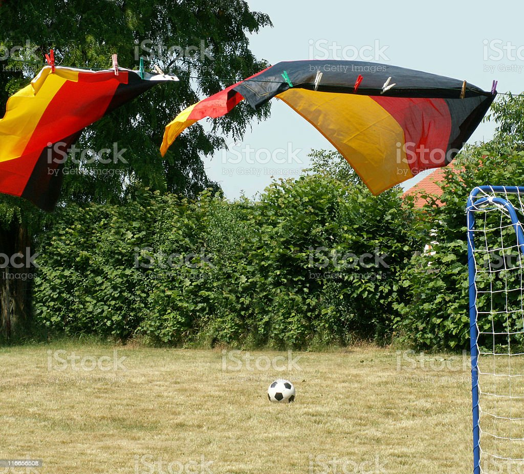 Small soccer field with ball, goal and german flags royalty-free stock photo