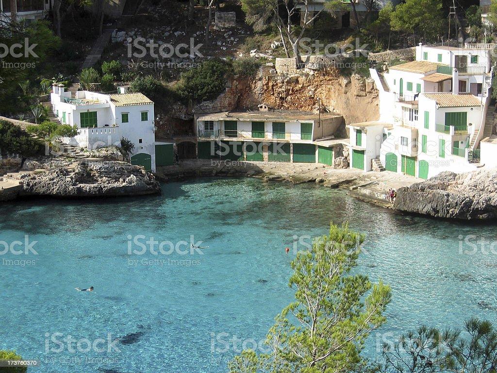 Small spanish bay with fishing huts royalty-free stock photo