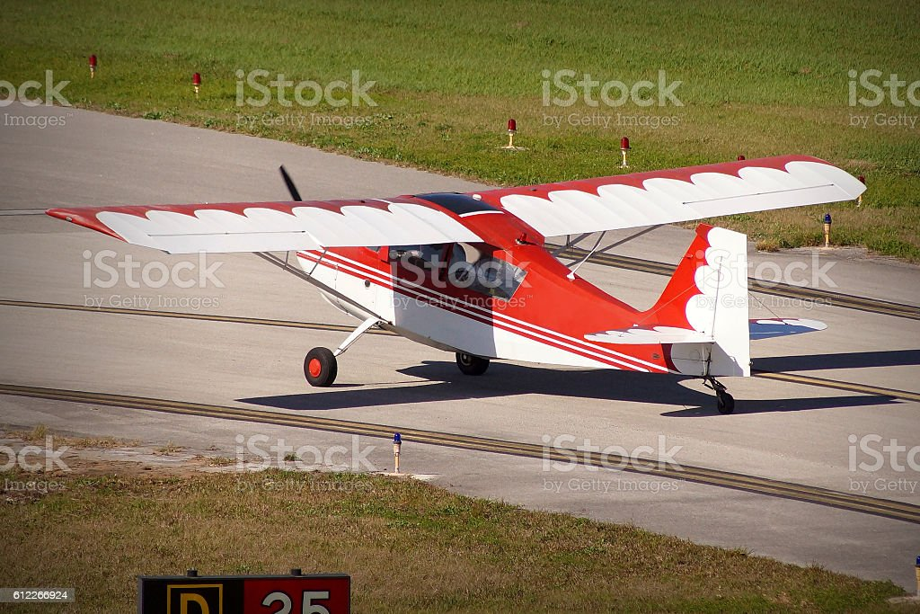 Small sports plane in an airport stock photo