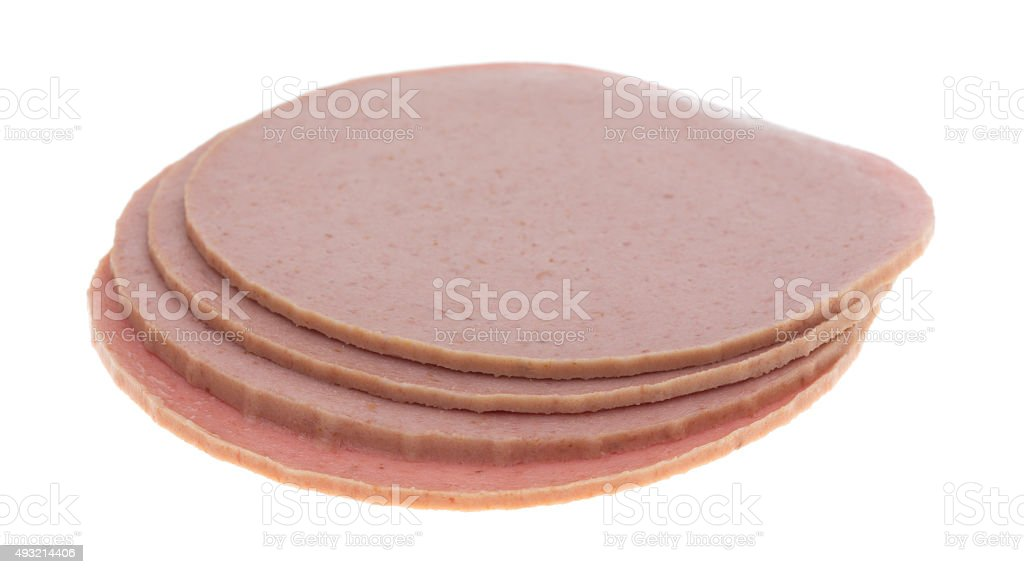 Small stack of bologna slices stock photo