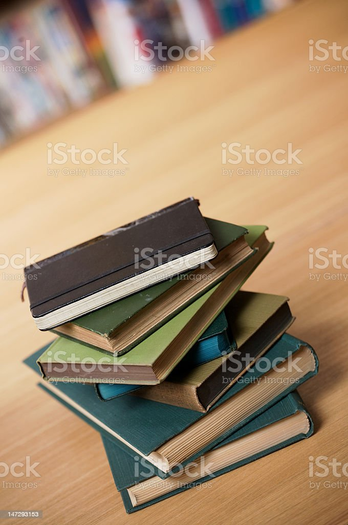 Small stack of books at an angle royalty-free stock photo