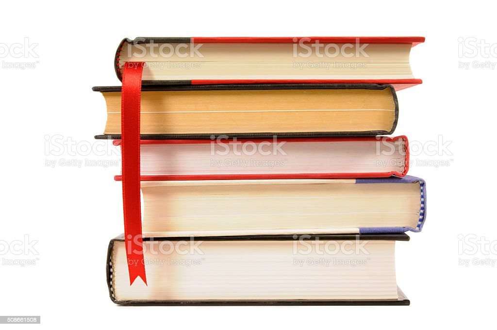 Small stack of hardback books with bookmark stock photo