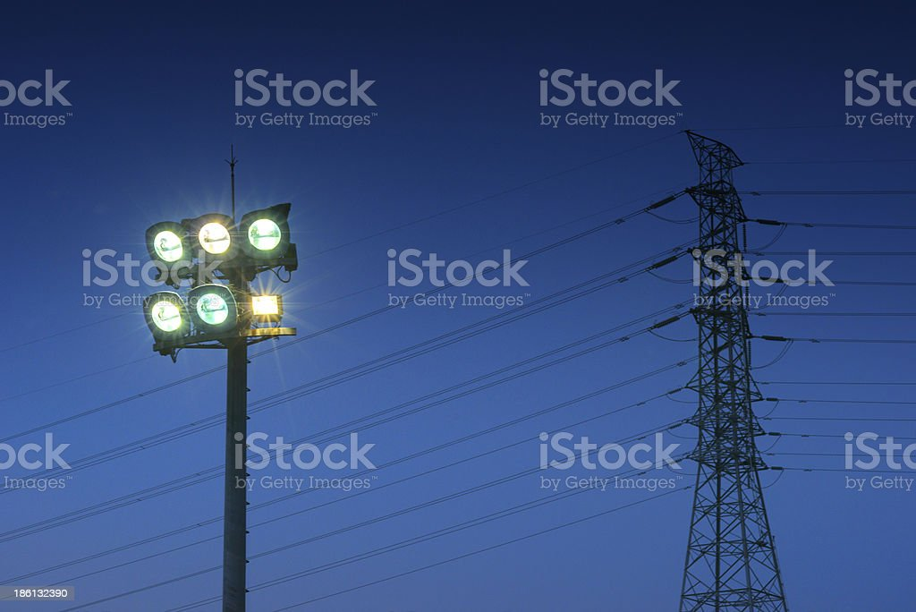 Small Stadium Lights   and High voltage Pole stock photo