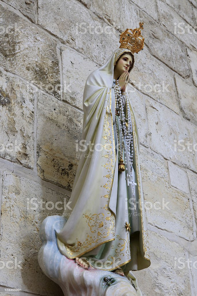 small statue of Virgin Mary stock photo