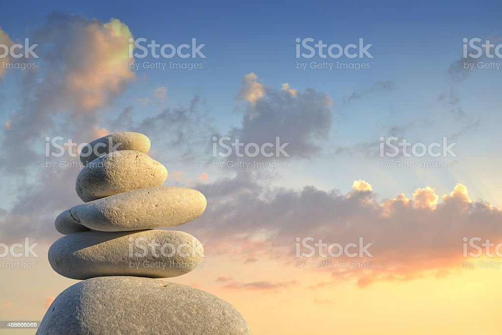 A small steinpyramide with a sky background stock photo