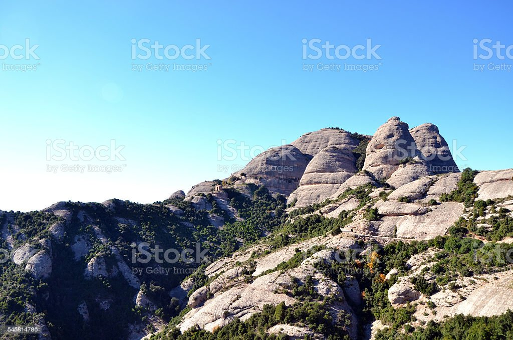 Small stone chapel on the mountains of Montserrat, Catalonia, Spain stock photo
