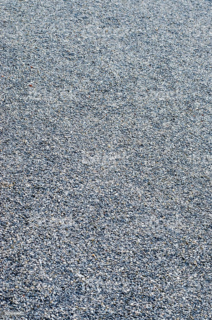 Small stones in footpath texture stock photo