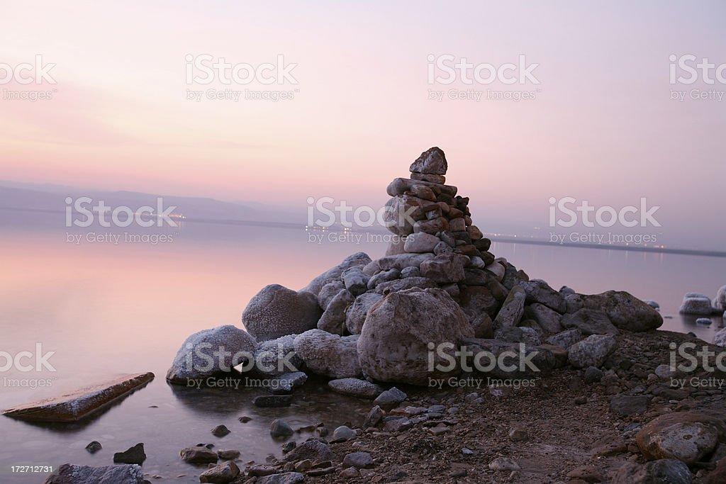 Small stones mountain at sunset / dead sea stock photo