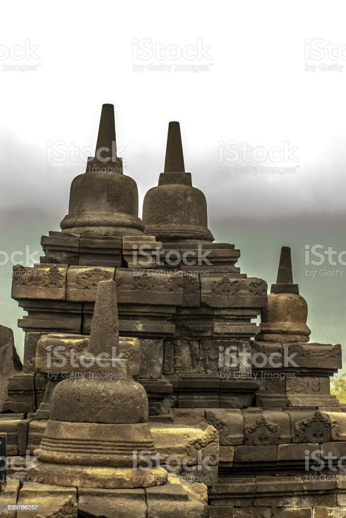 Small Stupas on a wall of Borobudur Java island, Indonesia stock photo