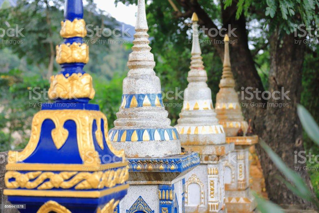 Small stupas-main entrance-Wat Pha Singkham temple. Muang La-Udomxai province-Laos. 3596 stock photo