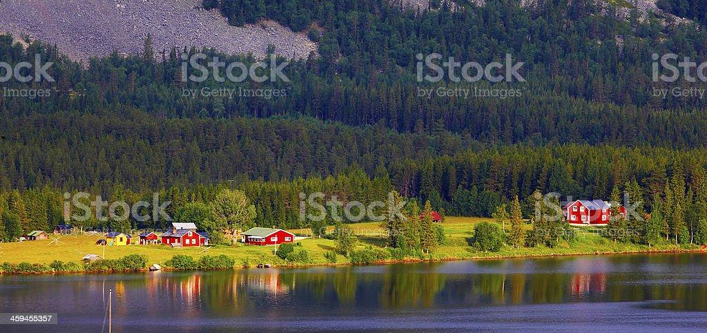 Small swedish village at the lake stock photo