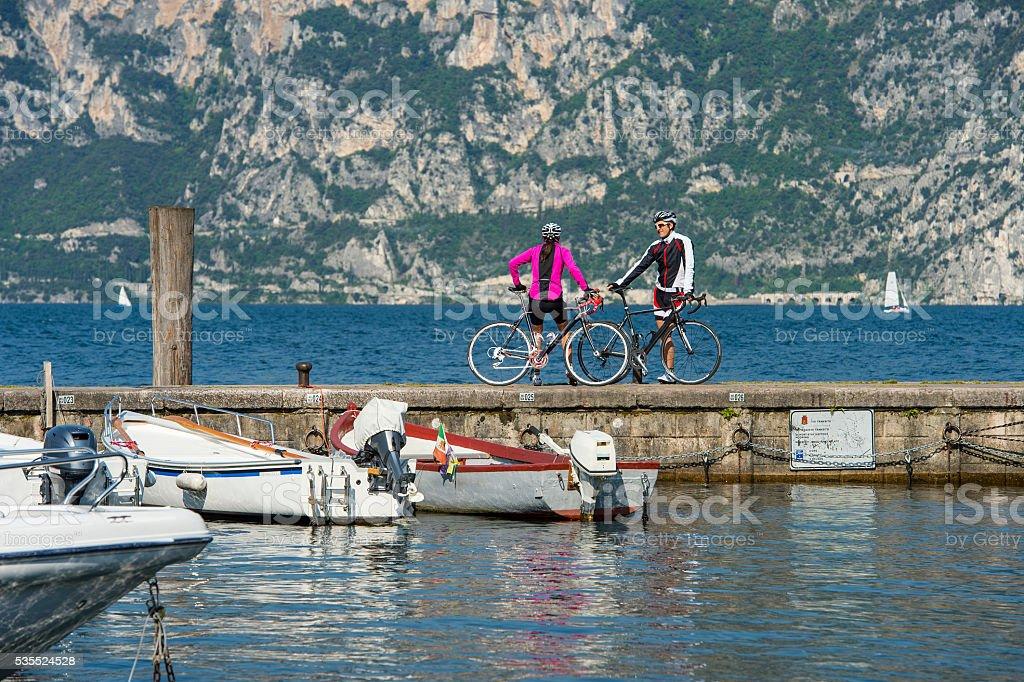 small talk at the lake after biking stock photo