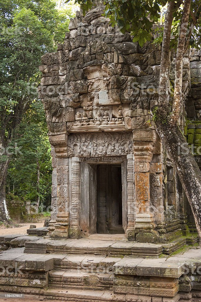 Small temple in Angkor jungles royalty-free stock photo
