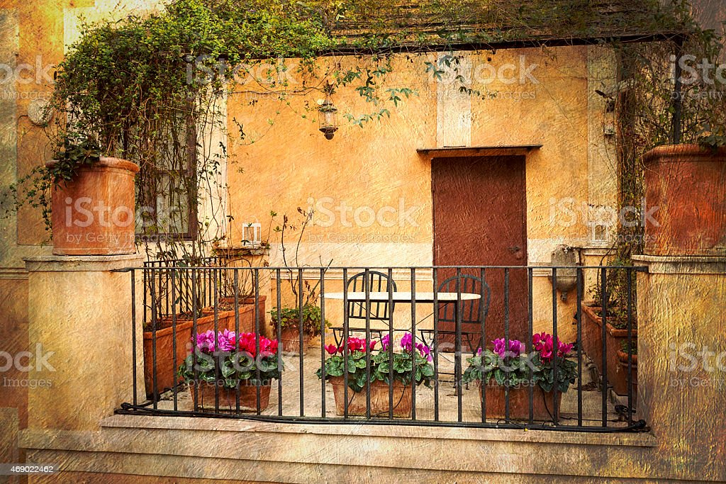 Small terrace decorated with flowers in Rome, Italy stock photo