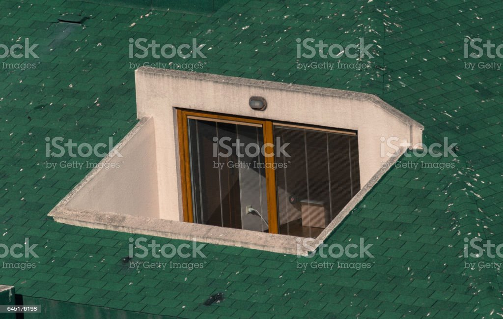 Small terrace on the top of a green roof stock photo