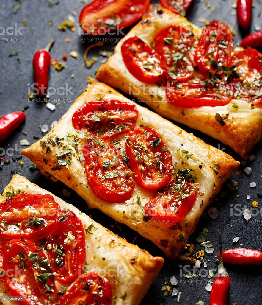 Small tomato tarts with addition of aromatic oregano stock photo