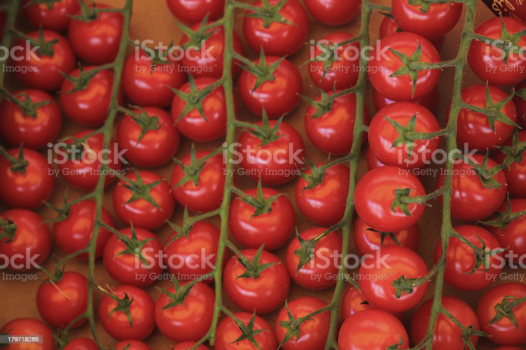 Small tomatoes at a market royalty-free stock photo