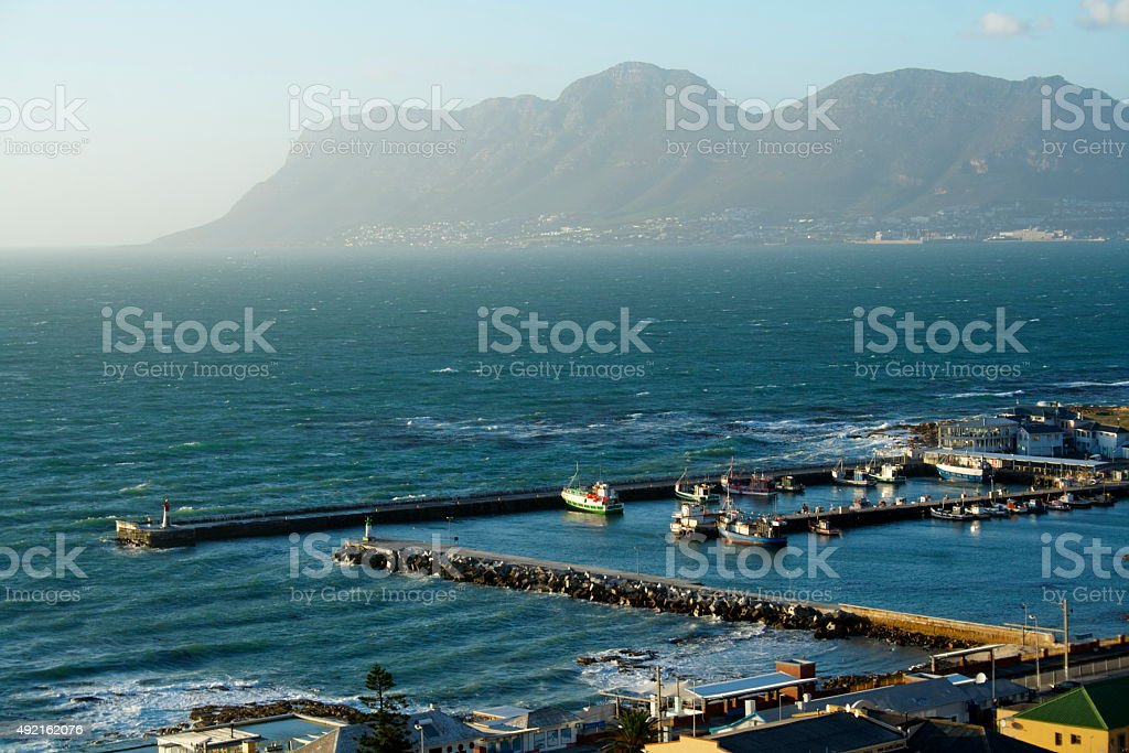 Small town harbour with mountain view stock photo