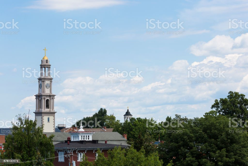 Small Town Steeples and Fluffy Cloudscape stock photo