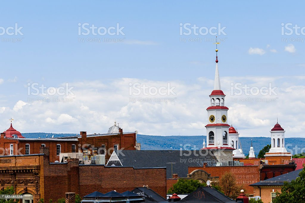 Small Town Steeples and Rooftops, Mountains In Background stock photo