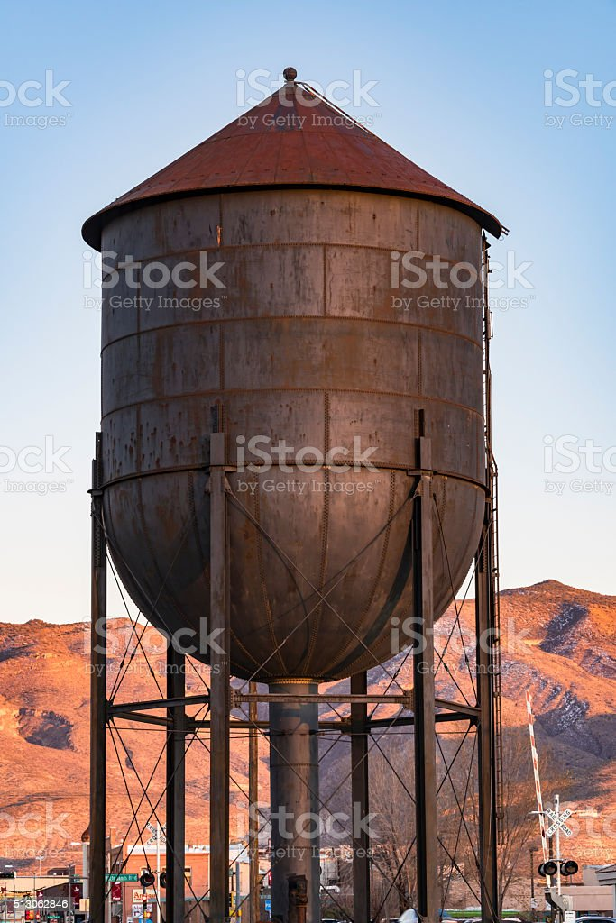 Small town water tank with mountains in background stock photo