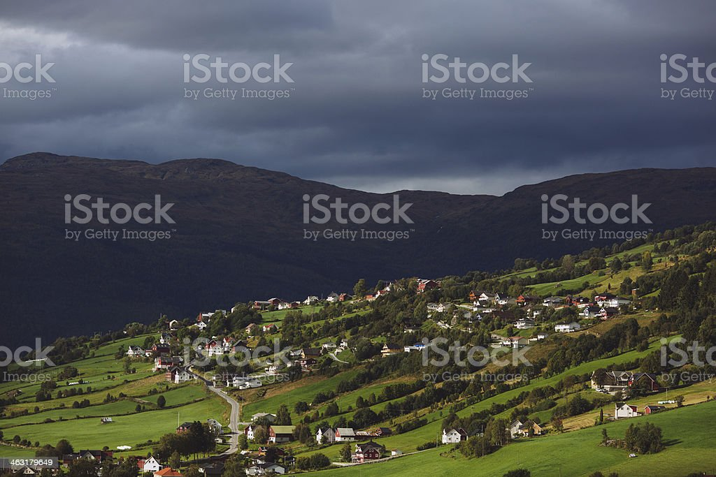 Small Town with Oncoming Storm - Western Norway stock photo
