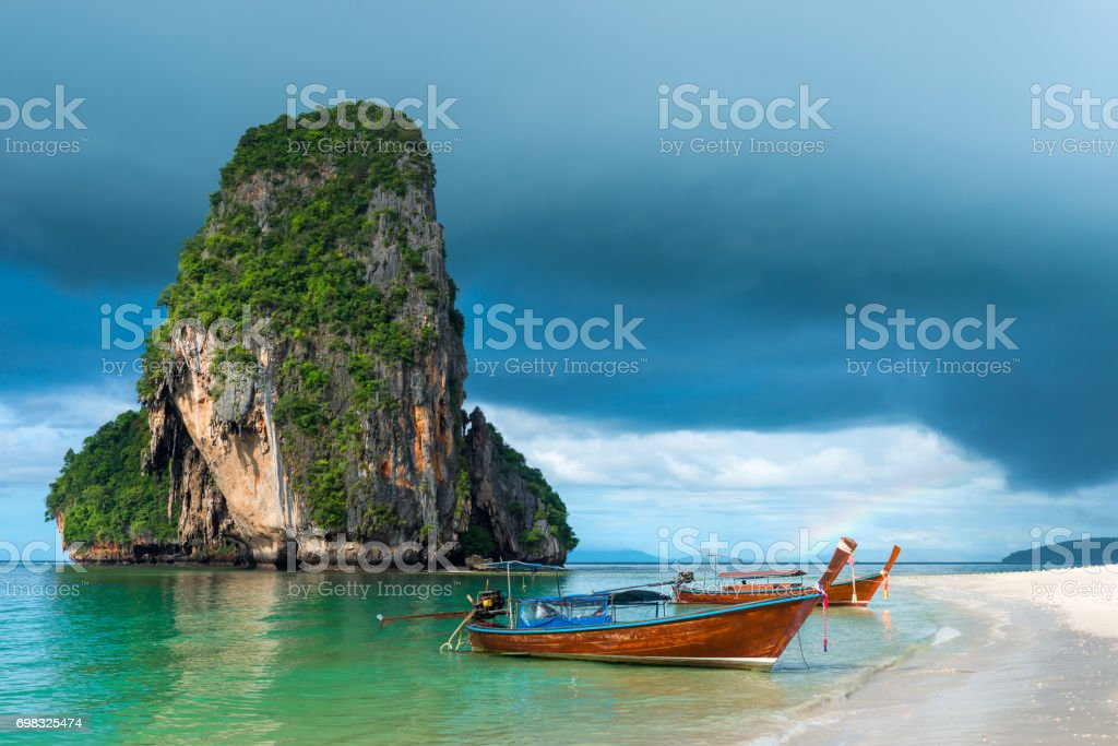 Small traditional Thai boats off the coast of Phra Nang, Thailand stock photo