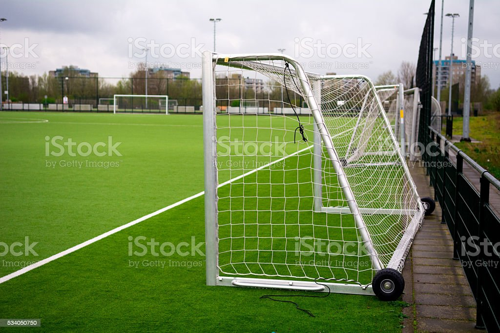 Small training goal on Artificial grass with chalk line stock photo
