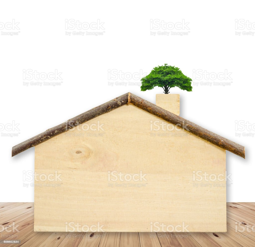 Small tree on blank wooden home model stock photo