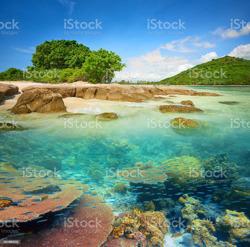 small tropical island with a coral reef. stock photo