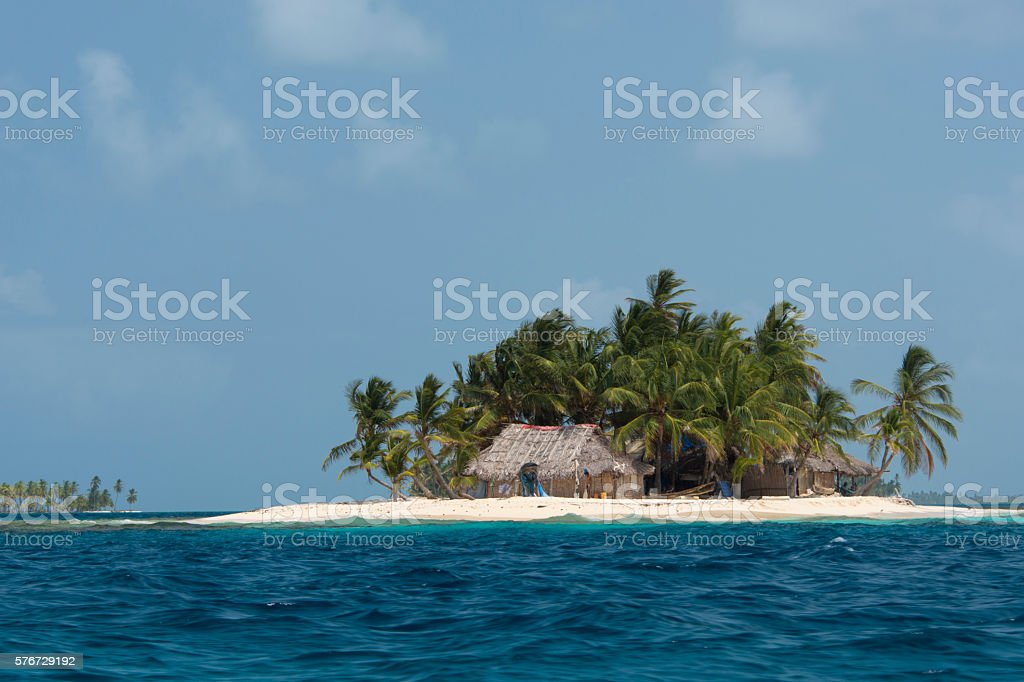 Small tropical island with bamboo hut stock photo