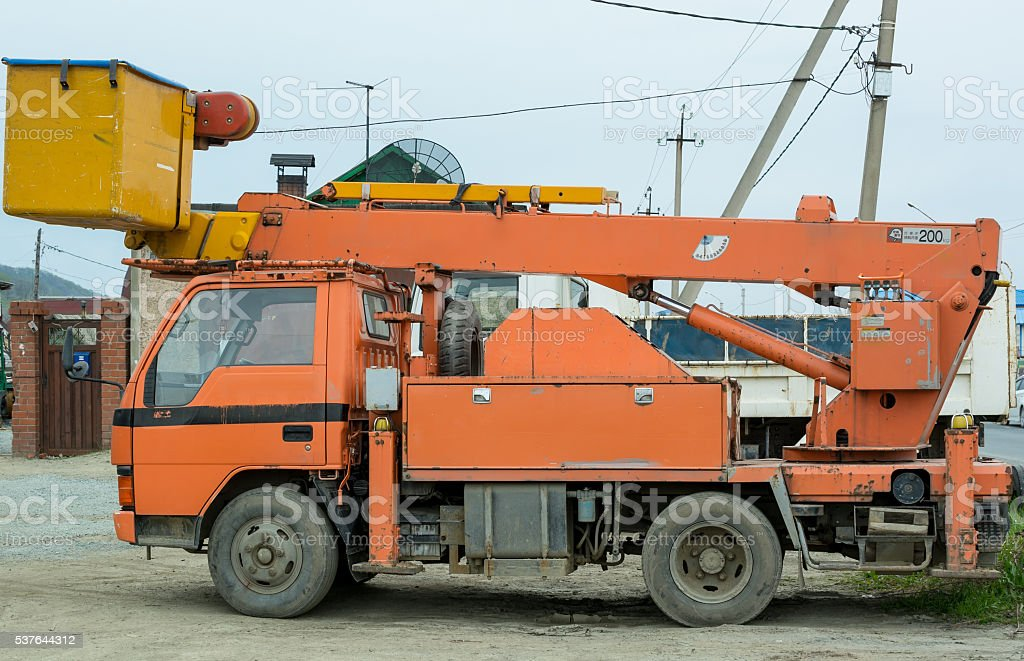 Small Truck with Hydraulic Boom. stock photo
