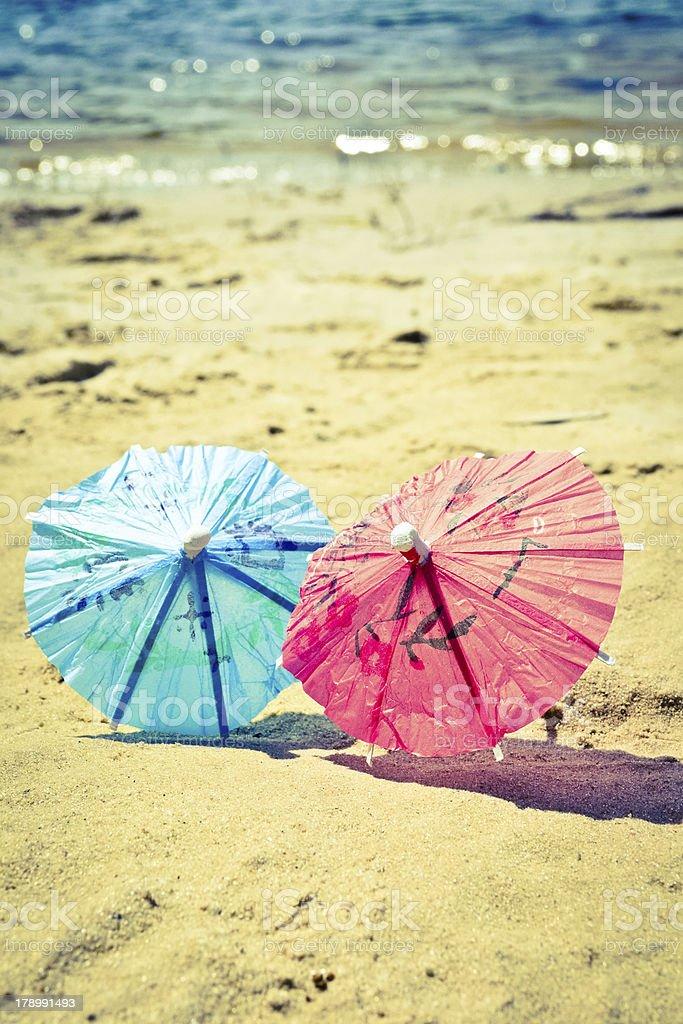 Small umbrellas on the beach royalty-free stock photo