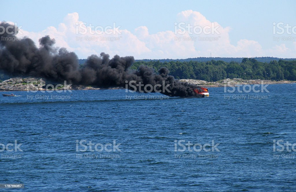 Small vessel catches fire and explodes on the sea. royalty-free stock photo