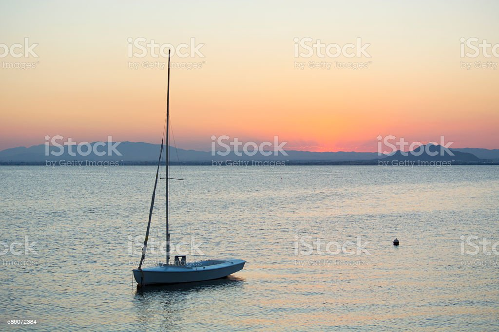 Small Vessel Sunset - La Manga, Mar Menor, Spain stock photo