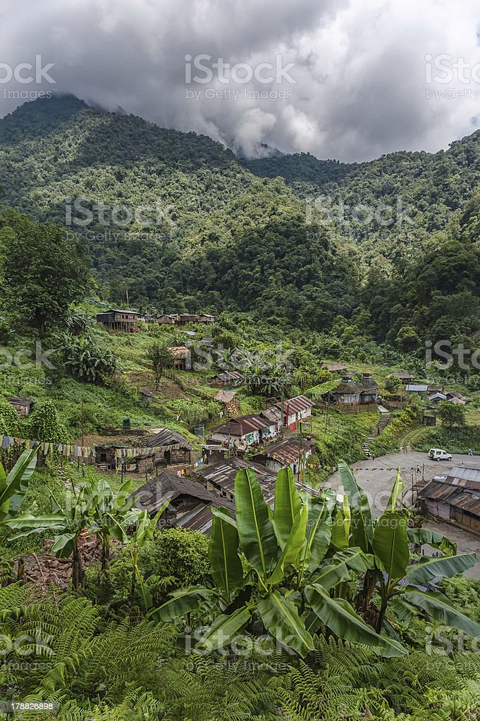 Small village, Buddhist prayer flags, and mountains, Arunachal Pradesh, India. royalty-free stock photo