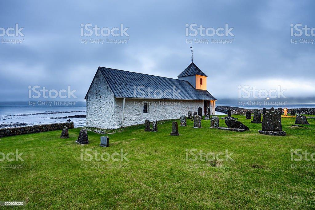 Small village church with cemetery in Kirkjubour, Faroe Islands, Denmark stock photo