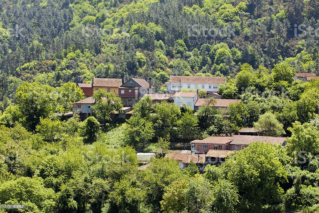 Small village in a green mountain countryside stock photo