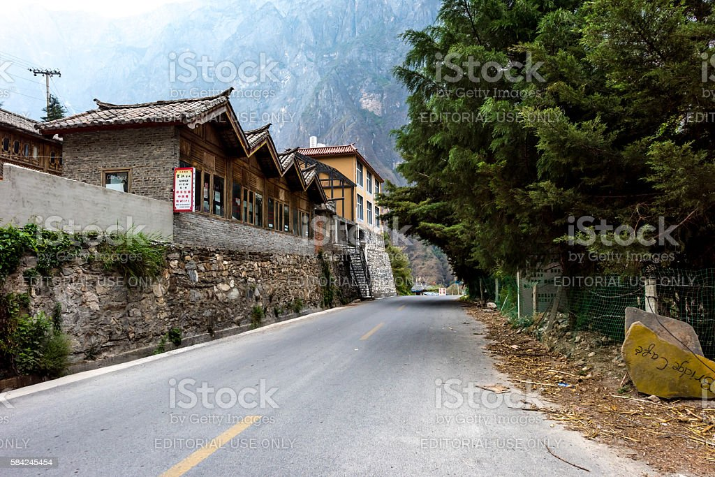 Small village in the middle of Tiger Leaping Gorge stock photo