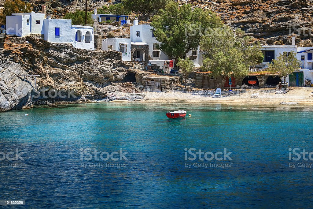 Small village in Tinos island, Greece, with transparent waters stock photo
