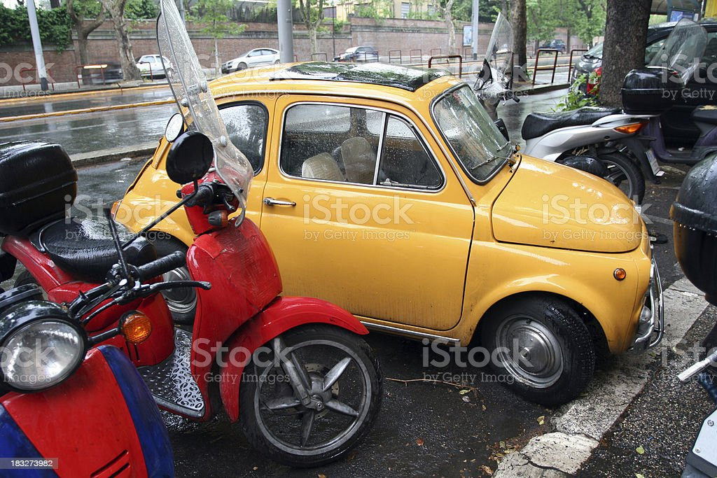 Small vintage car parked in Rome, Italy royalty-free stock photo
