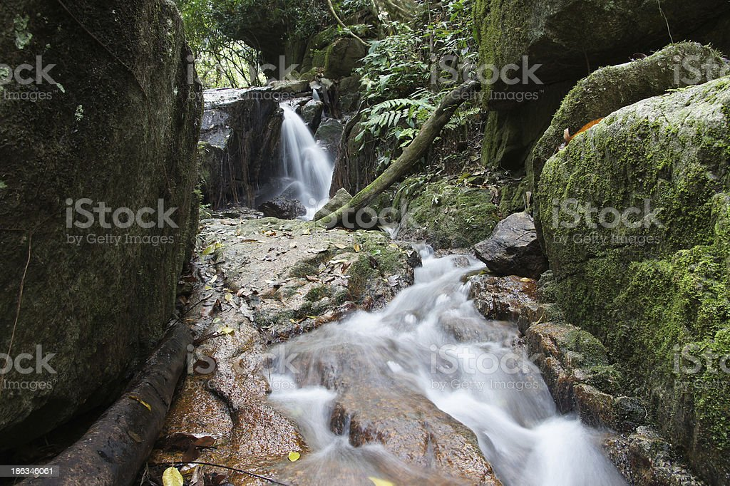 Small waterfall and rocks in forest, thailand royalty-free stock photo
