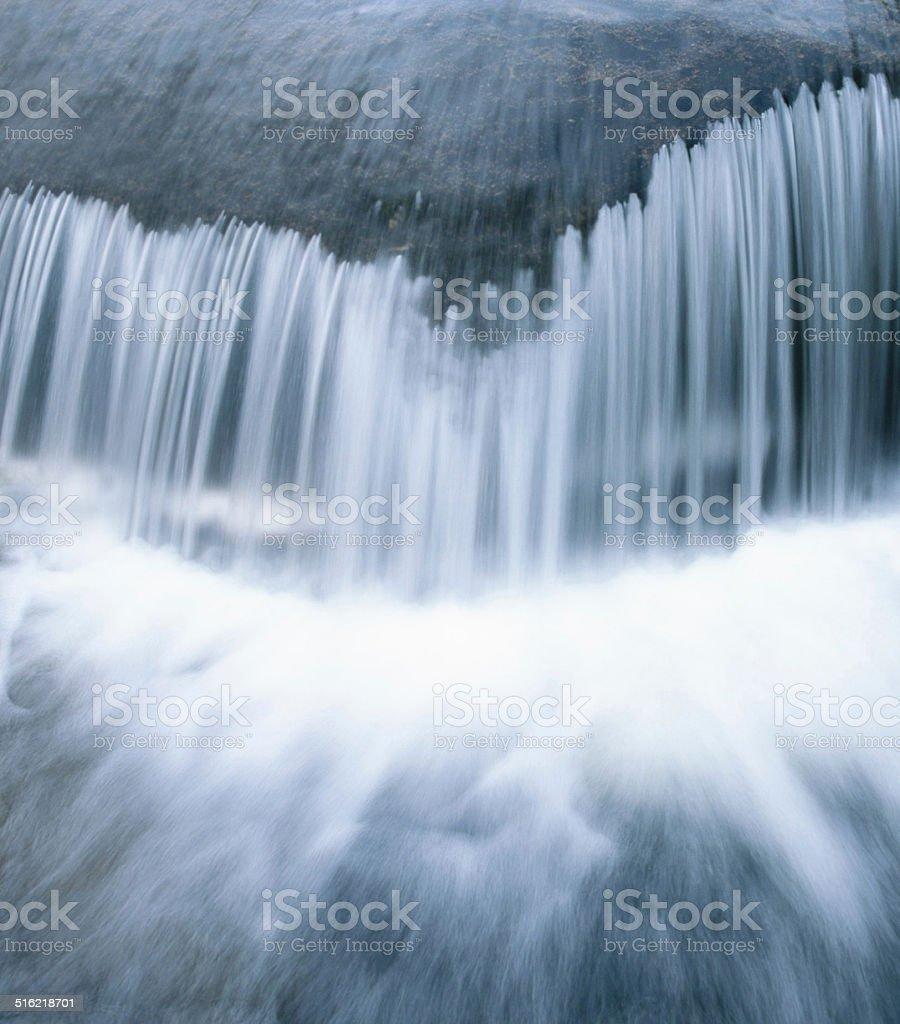 Small waterfall, blue toned, long exposure stock photo