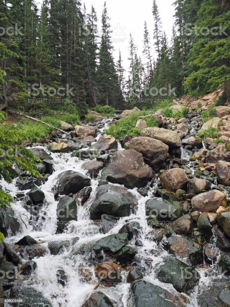 small waterfall in the Colorado Rockie Mountains stock photo