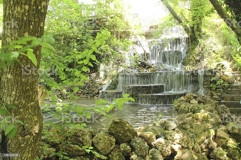 small waterfall in the forest royalty-free stock photo