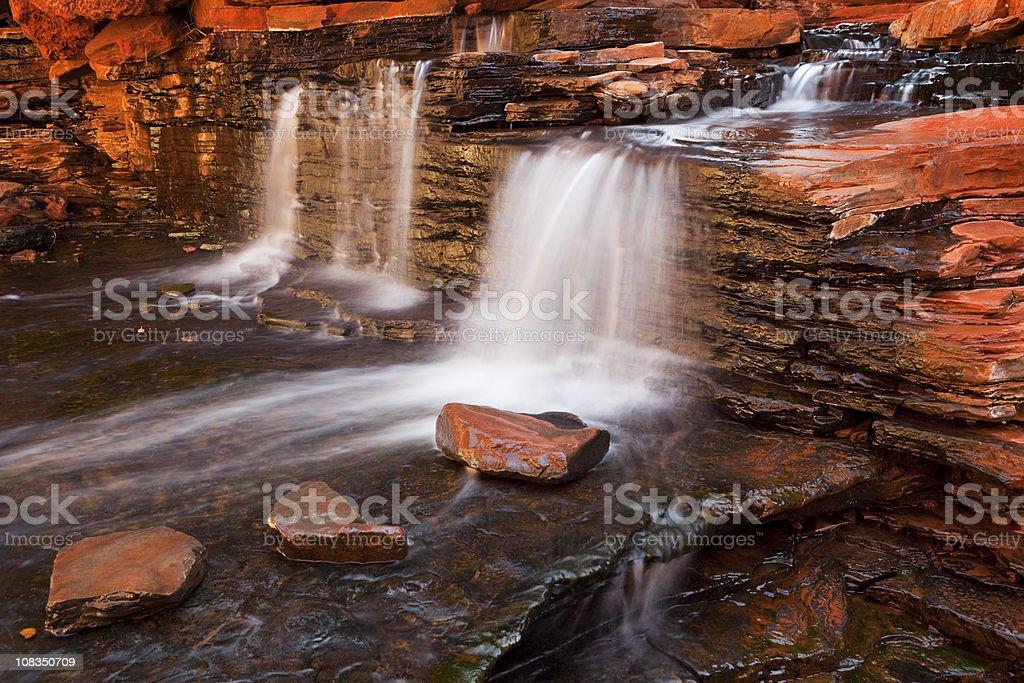 Small waterfall in the Hancock Gorge, Karijini NP, Western Australia royalty-free stock photo