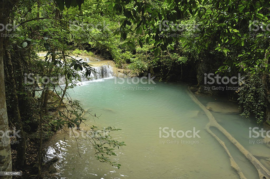 Small waterfall inside Erawan National Park royalty-free stock photo